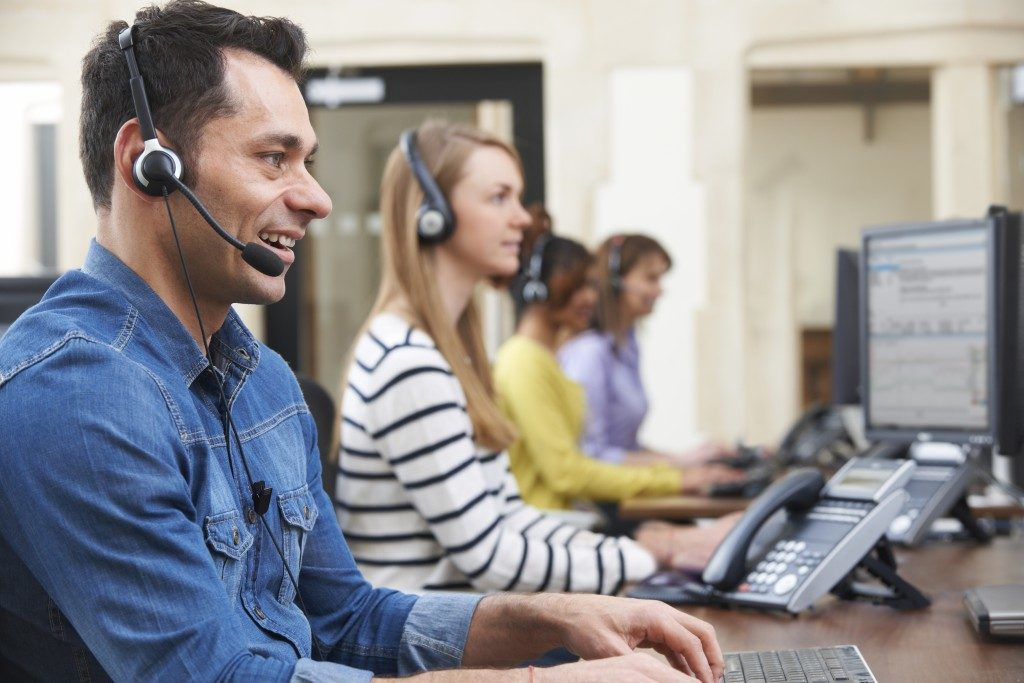 Customer service agents with headphones