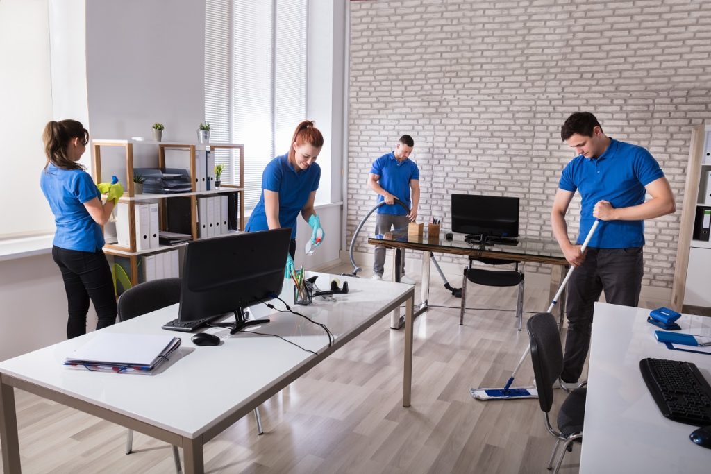 Workers cleaning an office