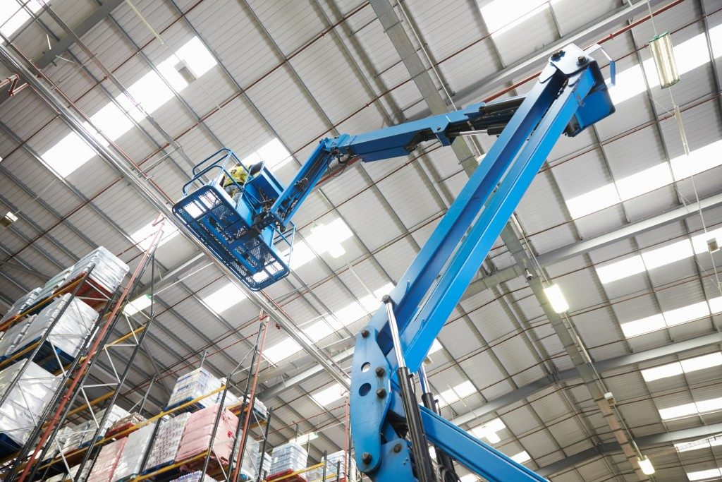Cherry picker in a warehouse