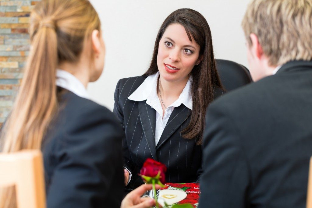 Woman talking to her clients