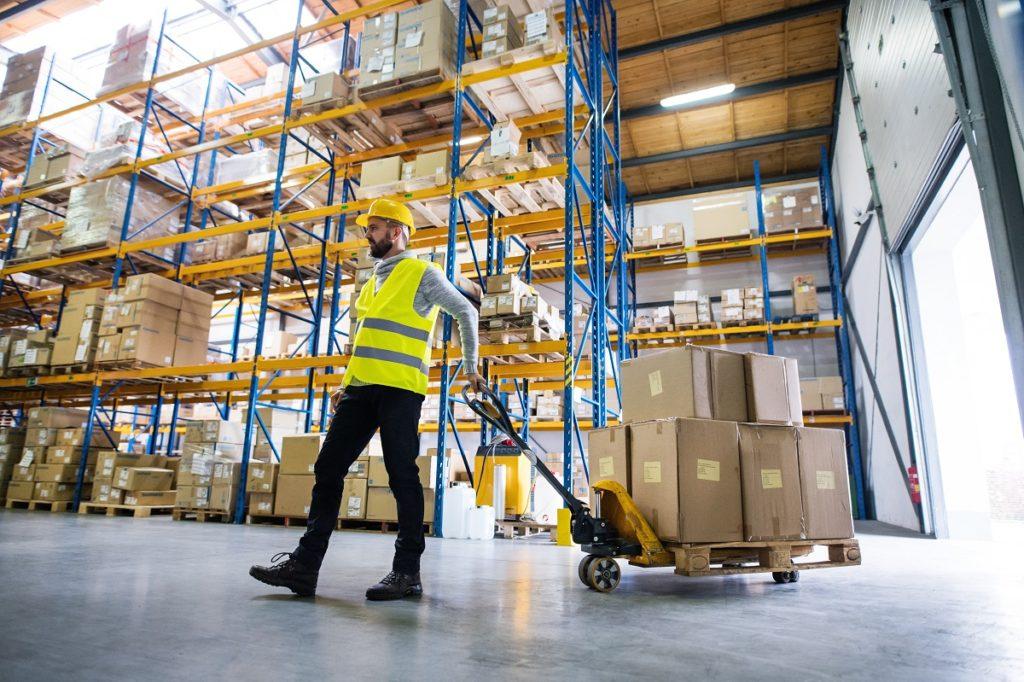 man operating ina warehouse