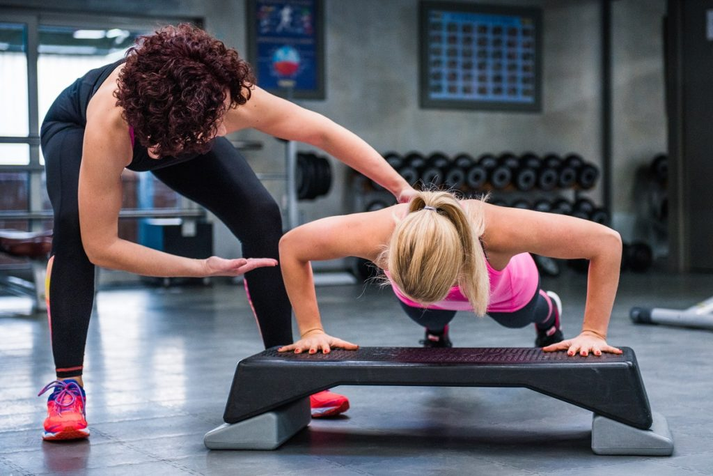 Woman with gym coach