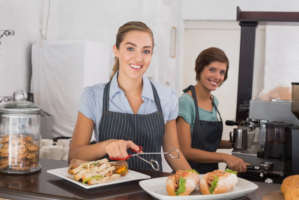 Female waitress serving