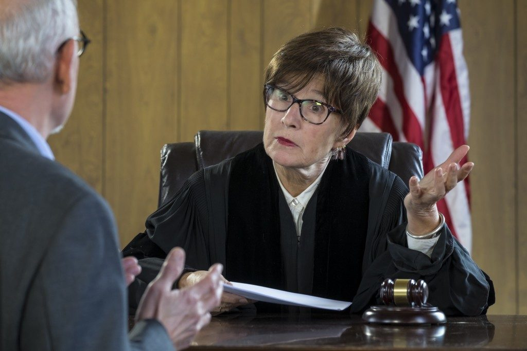 Judge talkling with a businessman