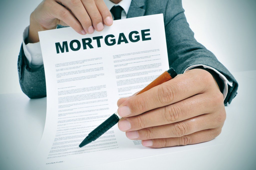A mortgage loan being presented with a pen