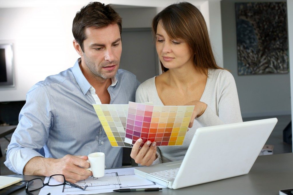 man and woman picking a color swatch