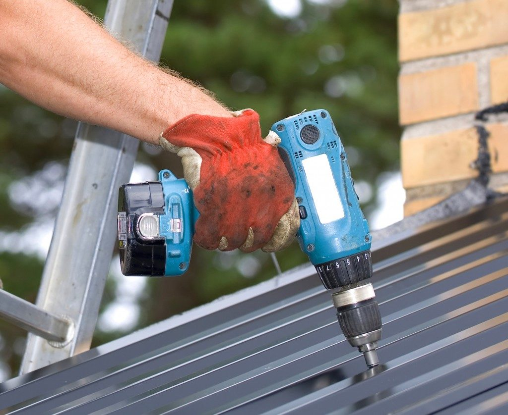 Working with a Power drill on a roof