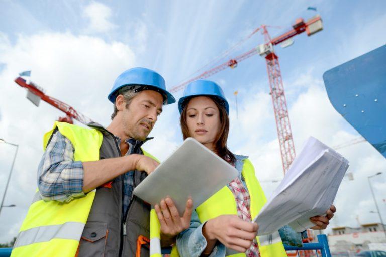 contractors looking at construction plans