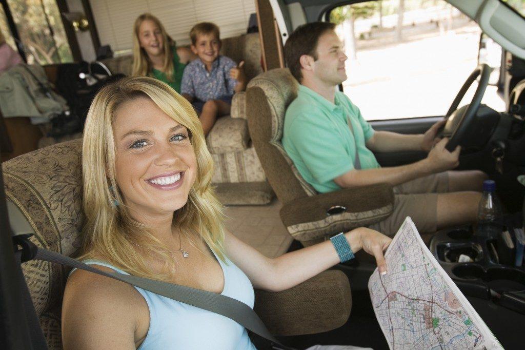family inside a camper van