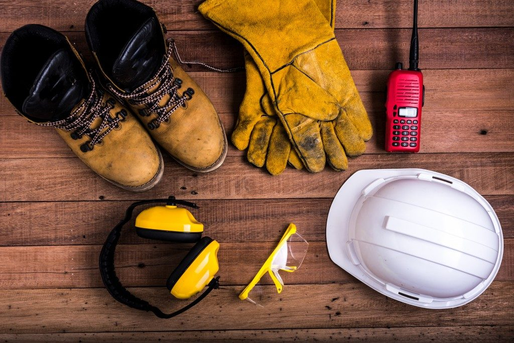 safety gear layed on wood background