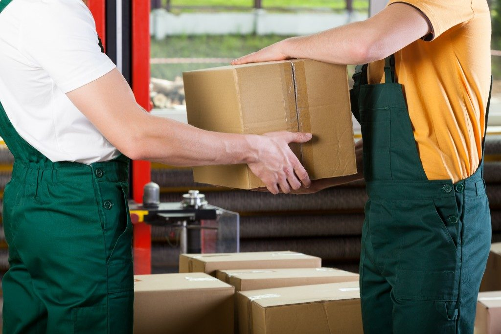 handing boxes of supply