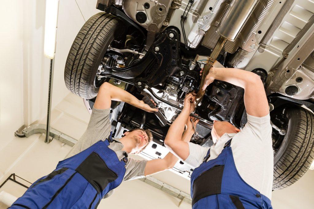 mechanics fixing car