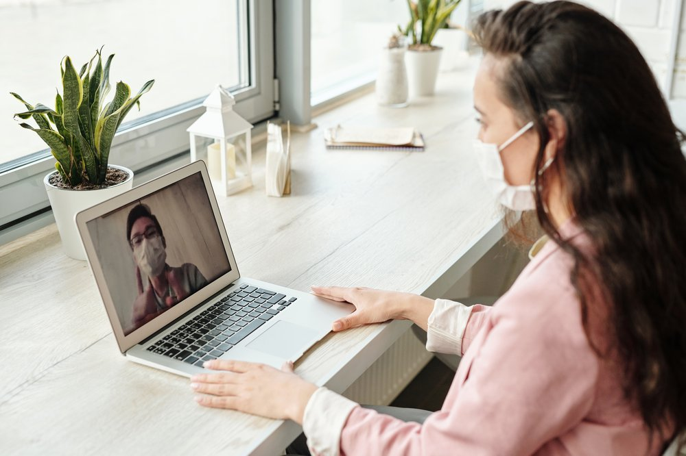 woman wearing a mask while on a video meeting
